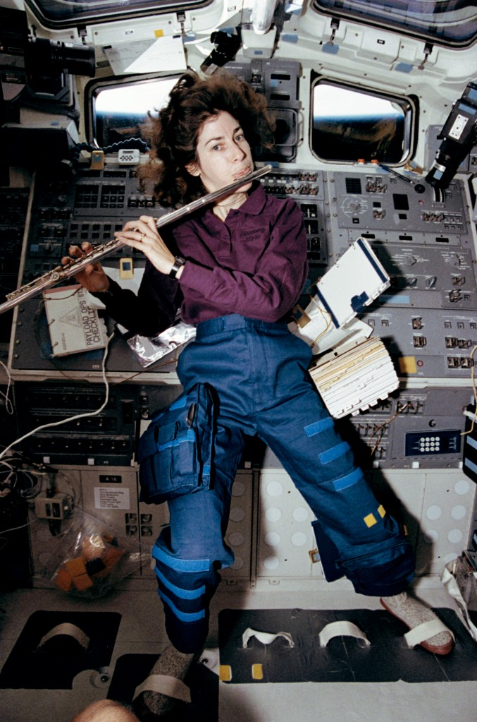 Interstellar improv! STS-56 Mission Specialist Ellen Ochoa plays the flute in space shuttle Discovery's aft flight deck in April 1993.  Image: NASA.